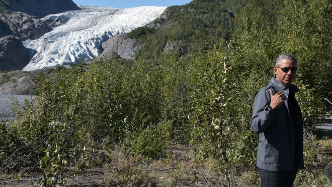 President Obama stops at a lookout while hiking near the Exit Glacier on in Seward, Alaska.
