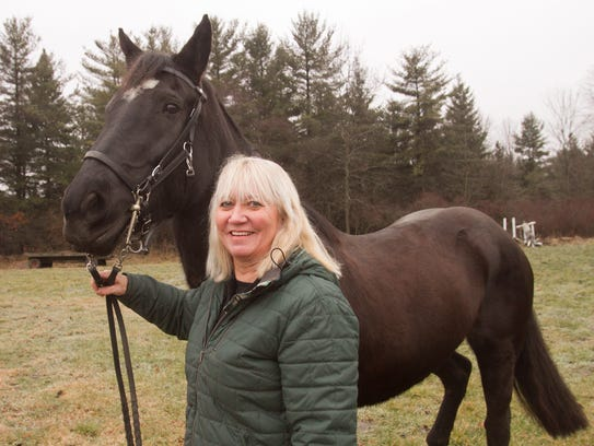 Diane Brady, a member of the county's mounted patrol,