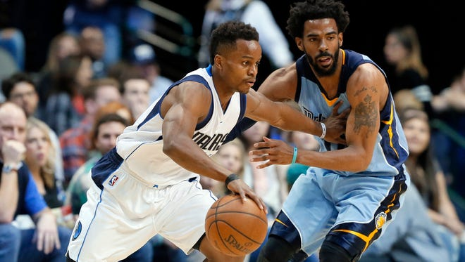 Dallas Mavericks' Yogi Ferrell, left, moves the ball against Memphis Grizzlies' Mike Conley during the first half in Dallas, Friday, March 3, 2017.