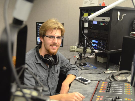 MTSU sophomore Joe Wasilewski of Knoxville prepares for his show at the student-run WMTS-FM 88.3 radio station.