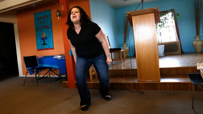 "Annette DiGiacomo performs her scene from ""The Vagina Monologues"" during a Jan. 30 rehearsal at the Unitarian Universalist Fellowship Hall in Farmington."