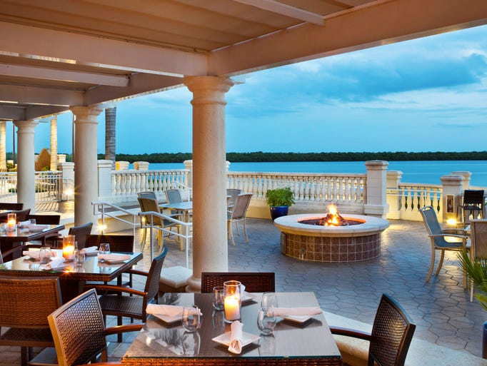 A waterfront resort stay at The Westin Cape Coral Resort at Marina Village is one vacation where the family pet is welcome (up to 45 pounds). Perfect for families, this 19-story property offers luxuriously appointed traditional one-, two- and three-bedroom suites with private, screened-in balconies and breathtaking views of the Gulf of Mexico, Caloosahatchee River and Tarpon Point Marina.        <p>Here, the outdoor patio of the Waterfront Bar Bistro.</p>