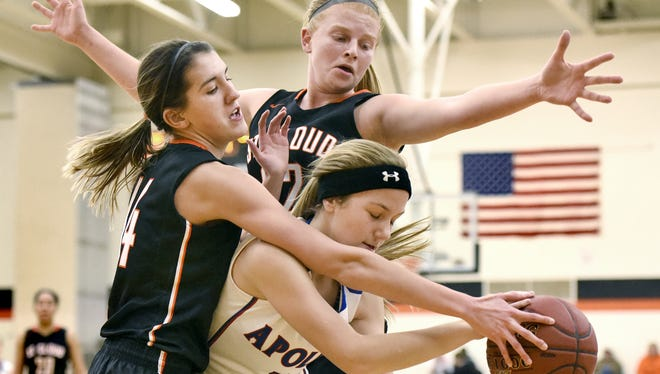 St. Cloud Tech's Sidney Angell and Kelsey Kline stop St. Cloud Apollo's Ashley Koepp from making a pass last January in a game at Tech. Angell and Kline are two key seniors this season for the Tigers.