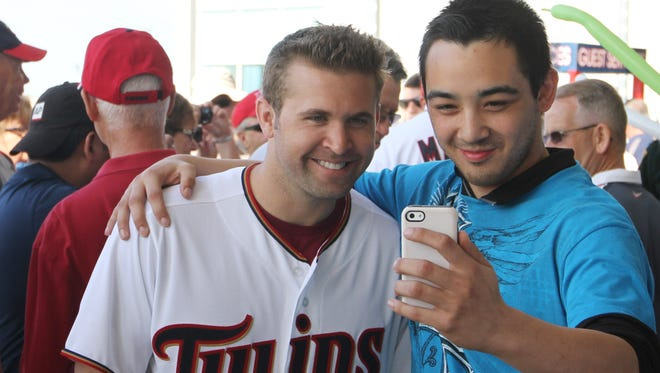 Christopher Mazzilli takes a selfie with Brian Dozier, of the Minnesota Twins, during an open house and ribbon cutting event at the CenturyLink Sports Complex on Sunday.