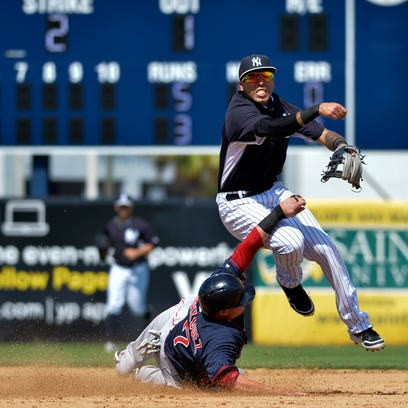 Shortstop Cito Culver leaps over Red Sox catcher Christian