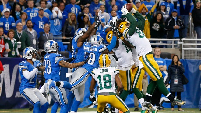 Green Bay Packers tight end Richard Rodgers, right, catches a 61-yard Hail Mary with no time remaining to beat the Detroit Lions, 27-23.