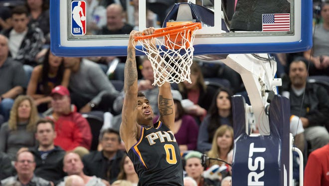 Feb 14, 2018; Salt Lake City, UT, USA; Phoenix Suns forward Marquese Chriss (0) misses on a dunk during the first half against the Utah Jazz at Vivint Smart Home Arena. Mandatory Credit: Russ Isabella-USA TODAY Sports
