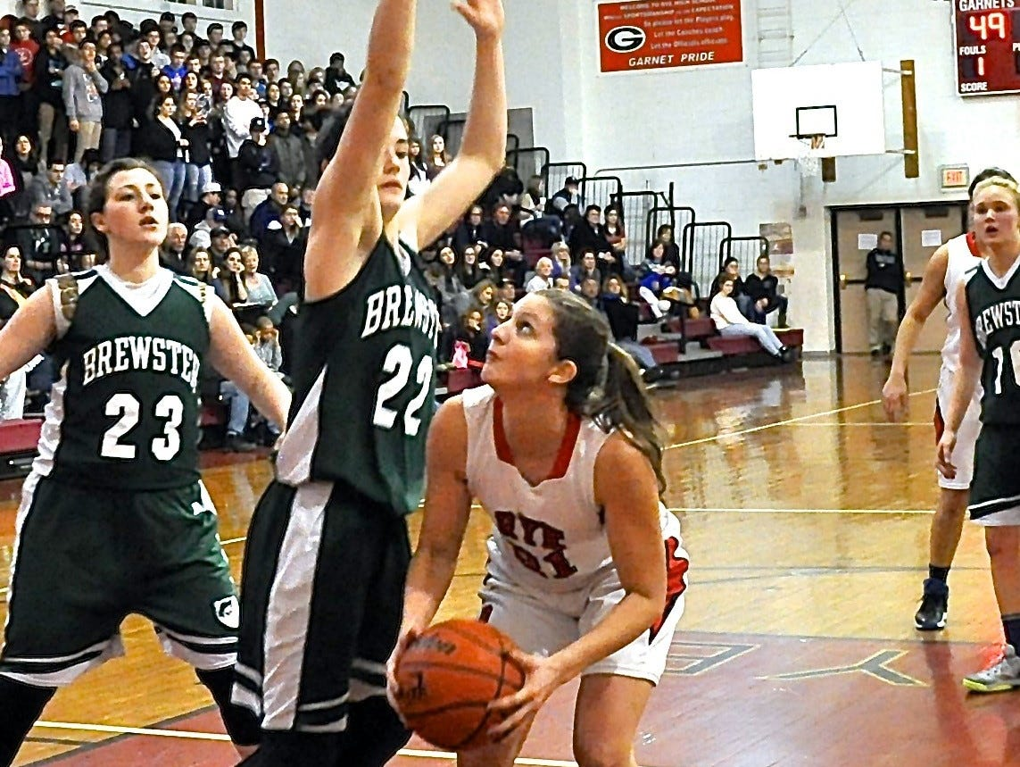 Brewster's Frannie Merkel defends as Rye's Madeline Eck tries to drivei inside in a Class A playoff game. The Garnets are playing Floral Park in the NYSPHSAA semifinals on Friday.