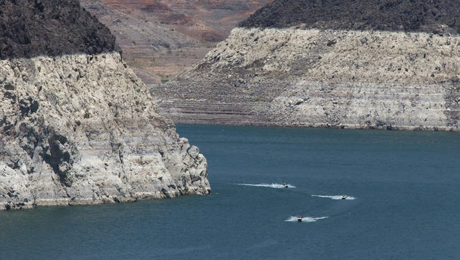 Jet skiers cruise on Lake Mead near Hoover Dam on June 20, 2015.