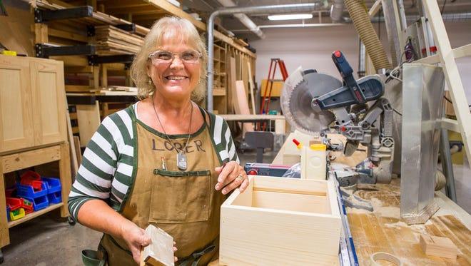 OTC student Linda Lober enrolled in wood working to honor her late husband.