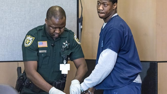 Derrick Jupiter, the driver in the February 2018 shooting and crash on Belvedere Road that left three dead, is fingerprinted after pleading guilty to lesser charges of second-degree murder and manslaughter in West Palm Beach Wednesday, January 8, 2020.