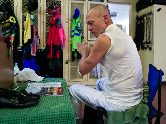 Jockey Calvin Borel checks out the Kentucky Derby program while getting ready for the first race at Churchill Downs. The C-J May 2, 2015