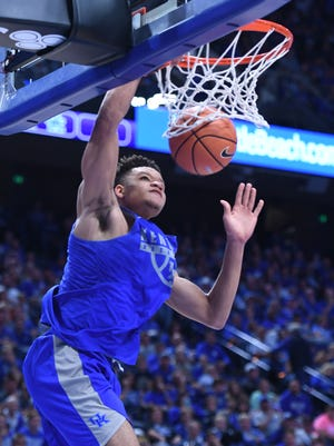 UK guard Kevin Knox dunks during the University of Kentucky mens basketball Blue-White scrimmage in Lexington, Kentucky, on Friday, Oct. 20, 2017.