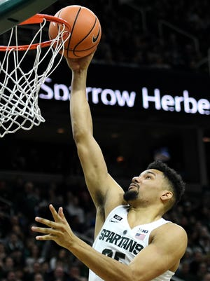 Michigan State's Kenny Goins scores during the second half on Saturday, Feb. 10, 2018, at the Breslin Center in East Lansing. The Spartans beat Purdue 68-65.
