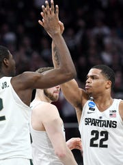 Michigan State's Miles Bridges, right, celebrates his 3-pointer with teammate Jaren Jackson Jr. during the second half on Friday, March 16, 2018, at the Little Caesars Arena in Detroit. The Spartans beat Bucknell 82-78 to advance to the second round in the NCAA tournament.
