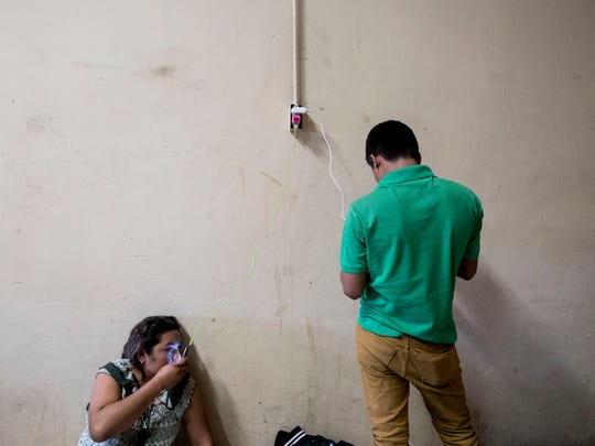 """130 migrants arrived at Hotel del Migrante, a migrant shelter in the border city Mexicali. The migrants from Central America as part of a """"migrant caravan"""" that started their northern journey from Tapachula, Chiapas, Mexico nearly a month ago The migrants will try to seek asylum in the United States. In this photo migrants charger their phones as they communicate with their loved ones in Central America."""
