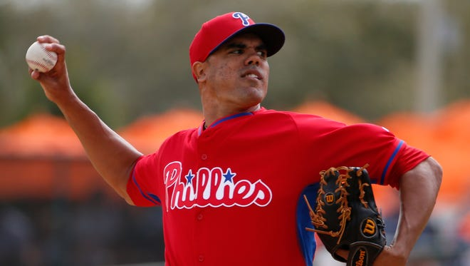 Philadelphia Phillies starting pitcher Miguel Alfredo Gonzalez throws in the fourth inning of an exhibition spring training baseball game against the Baltimore Orioles in Sarasota, Fla., Friday, March 7, 2014. (AP Photo/Gene J. Puskar)