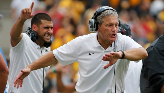 Iowa head coach Kirk Ferentz, right, celebrates as his defense comes off the field after stopping a Pitt drive during the fourth quarter of an NCAA college football game in Pittsburgh Saturday, Sept. 20, 2014. Iowa won 24-20.