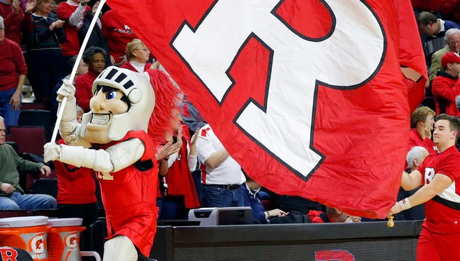 The Rutgers Scarlet Knights mascot leads the women's basketball team onto the floor against the Connecticut Huskies at Louis Brown Athletic Center.