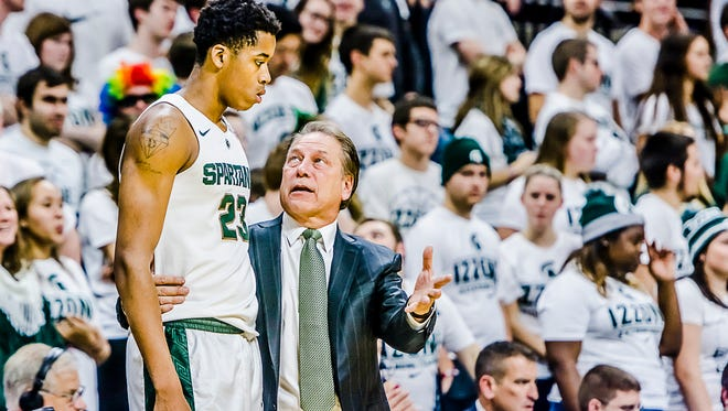 MSU Men's Basketball Coach Tom Izzo ,right, instructs Deyonta Davis during their game with Maryland Eastern Shore Wednesday in East Lansing.