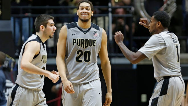 A.J. Hammons is all smiles as he heads to the Purdue bench during a Vanderbilt timeout in the second half Tuesday, December 22, 2015, at Mackey Arena. Purdue beat Vanderbilt 68-55.