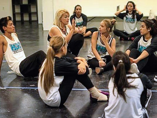 Jeremy Pearlman for the Sun-News Yvette Edgar (middle) going through the routine verbally. (left) Kento Nakano 15 (right of Yvette) Isis Janer 13 (right) Serenity Azure 13 prepare for class.