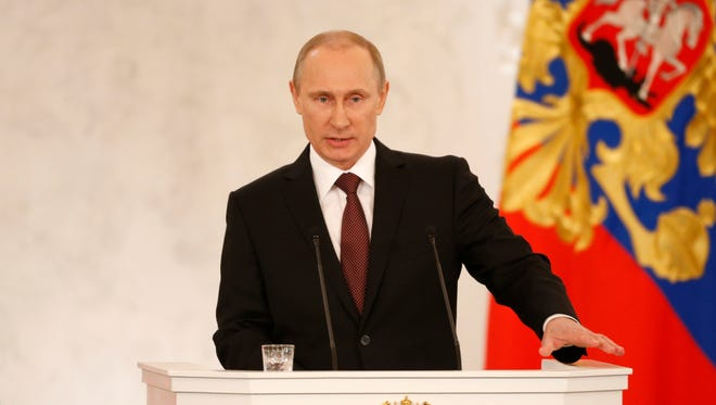 Russia's President Vladimir Putin addresses the Federation Council in Moscow's Kremlin on March 18.