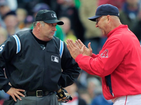 FILE - In this May 12, 2010, file photo, Boston Red Sox manager Terry Francona raises his hands as he argues a strike call during an at-bat by Adrian Beltre with Major League Baseball home plate umpire Dale Scott during the ninth inning of a game against the Toronto Blue Jays in Boston. Major League Baseball umpire Dale Scott says he is gay. The 55-year-old umpire who has worked three World Series tells the website outsports.com that he married his longtime companion in November 2013. (AP Photo/Charles Krupa)