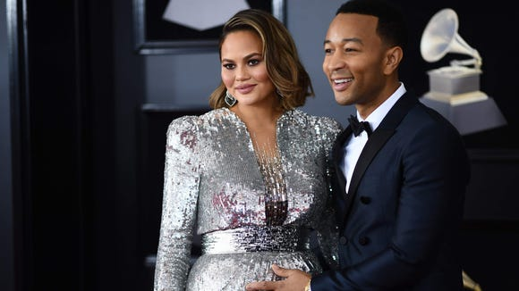 John Legend (R) and Chrissy Teigen arrive for the 60th