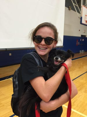 """Annie Judy with Bear, a """"Repuplican"""" running for president at St. Agnes School in Fort Wright."""