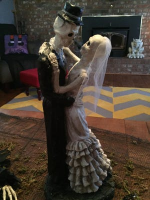 Gina and Mike Funaro decorated their Erlanger home on Timberlake Avenue inside and out in honor of their fifth wedding anniversary. The couple were married on Halloween in 2001.