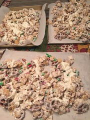 Kevin Davis' Christmas Mix recipe made enough to cover three cookie sheets. You can change and adapt the recipe to your own tastes. We used plain M&Ms instead of peanut ones.