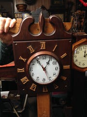 "This is the ""barber"" clock with backward numbers that Hayes made which, when reflected in a barber shop mirror, will show the real time."