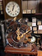 In the foreground of this picture at Jimmy Hayes' shop is a clock he built with a transparent face that shows off its wooden gears.