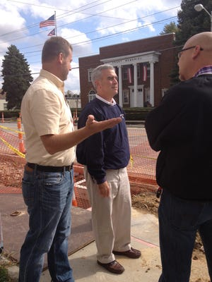 Bethel Mayor Alan Ausman (left) discussed streetscape improvements with Rep. Brad Wenstrup, the Republican representing Ohio's Second Congressional District, and Bethel Council Member Jeremiah Hembree during a tour of the village's business district last October.