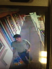 Surveillance camera photo from Mayfair Motel, Washington Township, N.J., of the suspect, Richard Smith, while he was on the lam.