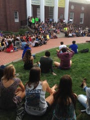Hundreds have gathered on UD's Memorial Hall's steps Friday afternoon.