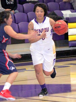 Western's Desiree Smith brings the ball upcourt during action Friday night at home. She led all scorers with 12 points in the loss to Pueblo.