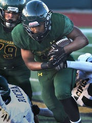Moorpark running back Nikos Booth Fortier bulls his way downfield against Pacifica.