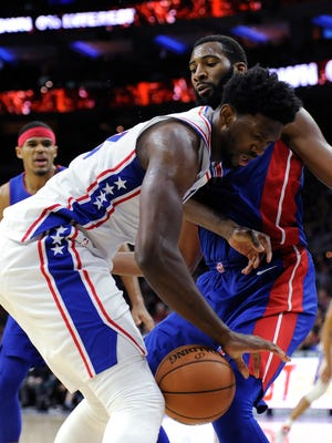 Joel Embiid drives to the basket as Andre Drummond defends during the second half Saturday.