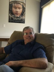 Author Andy Weir sits in his Sunnyvale, Calif., house