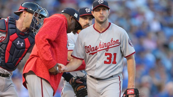 Nationals manager Dusty Baker removes Max Scherzer in the seventh inning of Game 3.