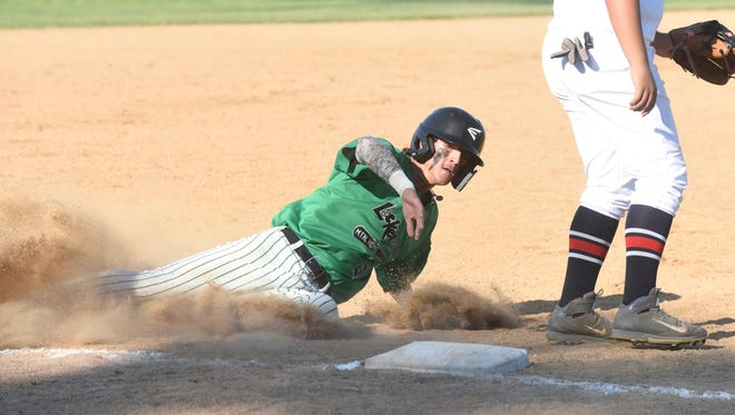 Lockeroom's Samuel Stowers steals third base against Rogers on Wednesday night at Cooper Park.