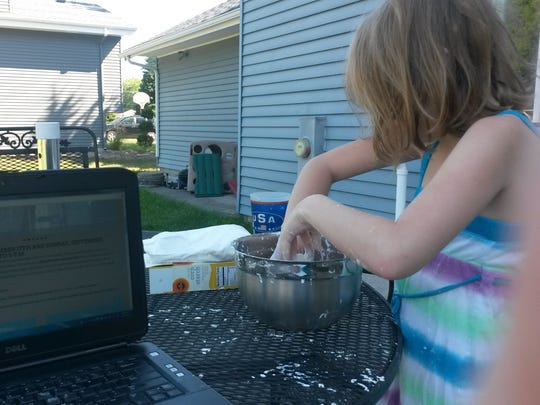 The typical life of a work-at-home mom: multitasking to get work done while the kids play nearby.