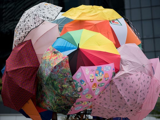 Umbrellas are clustered together to symbolize the umbrella revolution of pro-democracy demonstrations on Oct. 1 at the central government offices in Hong Kong. Thousands of pro-democracy activists have taken over the streets following China's refusal to grant political reforms.