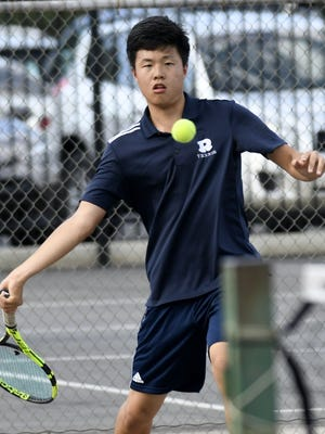Redwood's Tony Kim returns to Mt. Whitney's Seth Herrera in the #1 singles match at Mt. Whitney High School on Wednesday, April 25, 2018.
