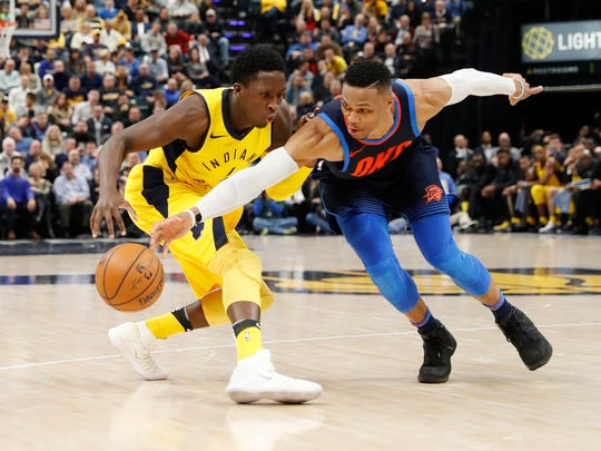 Dec 13, 2017; Indianapolis, IN, USA; Oklahoma City Thunder guard Russell Westbrook (0) knocks the ball away from Indiana Pacers guard Victor Oladipo (4) during the 4th quarter at Bankers Life Fieldhouse.