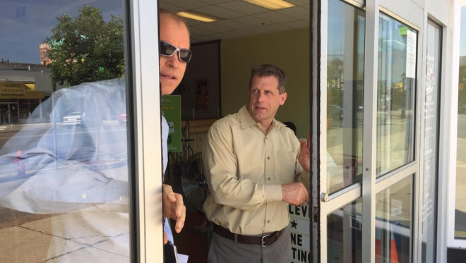 Russell Swanson, executive director of the Vineland Downtown Improvement District, exits the Landis MarketPlace upper-level entrance on Wednesday morning in front of market manager Robert Scarpa.