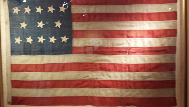 This 13-star flag was produced for the 1876 Centennial and has a 5-3-5 pattern for the stars. It is on display at Twin Lights courtesy of Dr. Peter J. Keim.