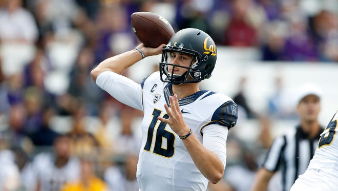 California Golden Bears quarterback Jared Goff (16) throws out a pass in the first quarter against the Washington Huskies at Husky Stadium.